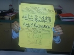 7th grader, Olivia F., shows off her completed shahada, or Islamic creed