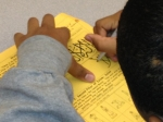 A student tries his hand at writing the Islamic creed, shahada