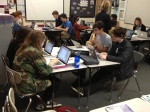 9th and 10th graders find online resources during humanities class