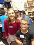 6th grader Niki L. (left) and 3rd grade buddy Ian N. smile for the camera