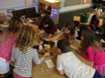 2nd graders mix colors to paint tree trunks for their 3D models