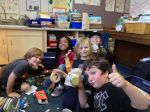 2nd graders build cars for their models out of recycled materials (l. to r., Toby M., Nnenne B., Truman L., Gibson P., and Will M.)