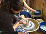 11th grader Jessica A. at the pottery wheel