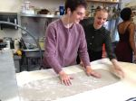 Senior Institute students, Spencer G. and Cat P. press a slab of clay for a ceramics project