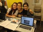 (l to r) Agnes A., Sarah SM., and Lindsay O. share their blog and petition with peer in humanities class