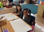 Audrey S. and Laurel H. proudly share their systems maps