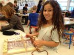 Leily K. shows off her weaving